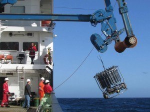 Bringing the CTD (an instrument which measures conductivity and temperature of seawater and depth, and collects water samples as it comes up) back on board the ship in slightly rough seas (hence, the swinging).